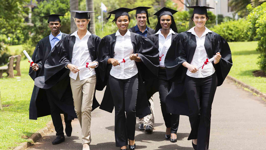 College Grads with gowns and diplomas