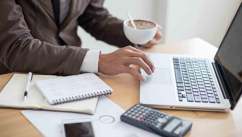 Businessman sitting at laptop