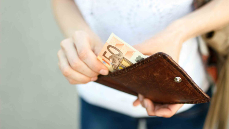 Woman taking money from wallet